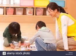 Nursery Teacher Nursery Teacher Watching Children Stock Photo 29080614 Alamy