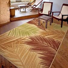 good quality outdoor indoor modern area rug shades of beige red brown