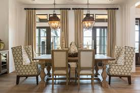 pretty wall candle holders transitional dining room with wingback armchair alongside with wood dining table and