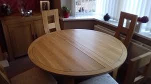 round oak extending dining table and four chairs