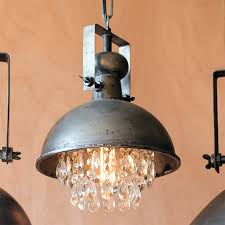 when masculine meets elegant you get this amazing light brushed metal hood with industrial detail glass gems hanging form underneath the dome dimensions