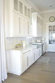 modern kitchen backsplash with white cabinets. Sherwin Williams - On The Rocks Wall Color And BM Decorators White Cabinets. Transitional Modern Kitchen Tour With Farmhouse Touches, Carrara Backsplash Cabinets I