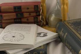 Astrology Books And Hourglass In Psychic Office Editorial