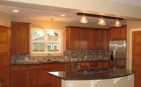 new kitchen cherry cabinets granite countertops and custom light fixtures