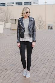 how to wear a leather jacket leather jacket outfits leather jacket outfit sweater layered over striped t shirt nike roshe sneakers with