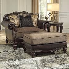 traditional chair and a half ottoman