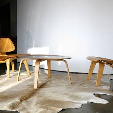 cow skin rug with modern table and chairs