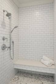 clad in white subways this well designed walk in shower features a polished nickel exposed plumbing shower head and sprayer