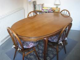 set of ercol chairs and oval solid wood dining table