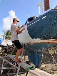 painting the hull sailboat painting sailboat restoration roll and tip verywellsalted