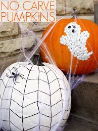 decorate your pumpkins with thumb tacks ghost and painted spider web