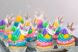 Unicorn Cupcakes With Multicolor Buttercream Icing On Metal Tray
