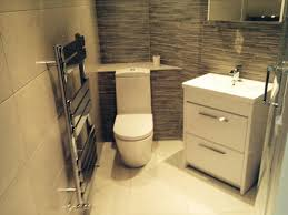 stylish bathroom furniture. stuart from sunderland efficiently uses space in this small bathroom with firstrate white furniture and a stylish chrome radiator i