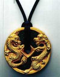 it is a chinese custom to offer coins as a gift to wish someone luck and attract fortune and prosperity the dragon on the lladro porcelain pendant plated