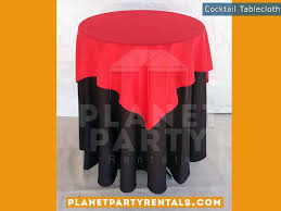 Black Tablecloth on cocktail table with red overlay | Tablecloth / Linen  Rentals