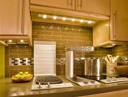 over stove lighting. Awesome Kitchen Light Fixtures Design Under Wooden Cabinet As Well Gray Granite Countertop Backplash Plus Behind Over Stove Lighting I
