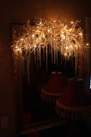 diy lighting projects. branches with white lights and icicles for christmasover a mirror or table diy lighting projects