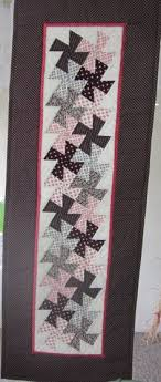 QIS: Here's what the template for a twister quilt looks like. I ... & Here is the version of the Lil' Twister table runner I made using my Lil' Twister  ruler from CS Designs. (this would be nice in autumn colors, or Christmas  ... Adamdwight.com