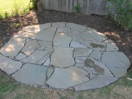finishing touches on a flagstone patio