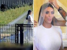 while kim s dress certainly did that her veil made the entire look much more toned down and demure to be appropriate for her ceremony