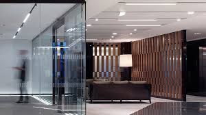 nulty global trading house london office reception area seating glass entrance lighting design