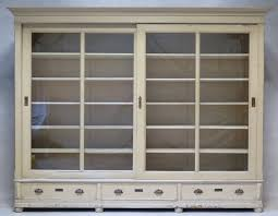 elegant and understated bookcase or vitrine from the early 1900s with two large sliding doors