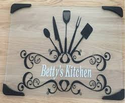 glass cutting board with rubber corners and black decals