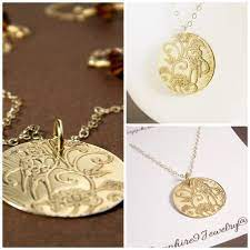 etched bird necklace bronze etched