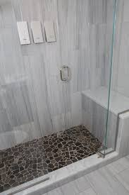 hotel bathroom custom shower gray flannel honed marble vertical running bond bench island stone large random