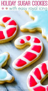 holiday cut out sugar cookies with easy royal icing recipe by sallysbakingaddiction
