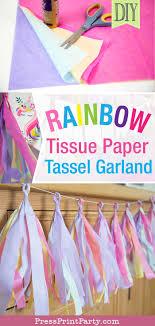 tassel garland on buffet with text rainbow tissue paper tassel garland diy