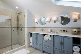 bathroom features blue double vanity walk in shower