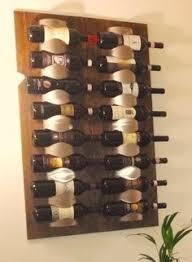DIY Wine Rack: Two wooden panels and Ikea metal bottle holder