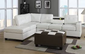 l white leather sectional sofa with chaise and back added by black and white leather ottoman on the rug
