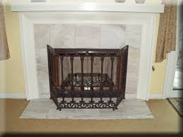 but can you spot why this fireplace made our how not to do it well take a look behind those beautiful flames at those ugly unpainted dirty walls
