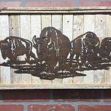 accent a cozy country theme with buffalo herd metal wall decor made of die cut metal this charming piece offers a rusted finish with buffalo herd  on die cut metal wall art with accent a cozy country theme with buffalo herd metal wall decor made