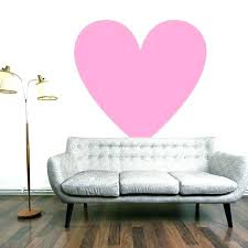 chandelier wall decal target with white wall decal large pink heart vinyl sticker on white wall behind empty grey couch with target rhinestone chandelier