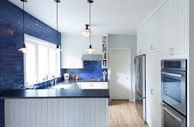 1920s english style kitchen in royal blue and