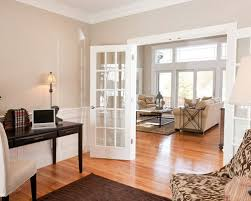 office french doors. example of a classic freestanding desk medium tone wood floor and beige home office design french doors