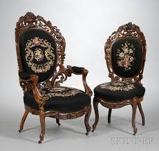 two belter type victorian rococo revival needlepoint upholstered carved rosewood laminated parlor chairs