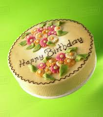 Cake With Marzipan Flowers And The Words Happy Birthday Stock