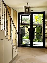 dream entryway iron metal gl doors and a courtyard