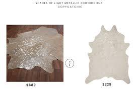 shades of light metallic cowhide rug 689 vs clayton champagne faux cowhide rug 229 metallic