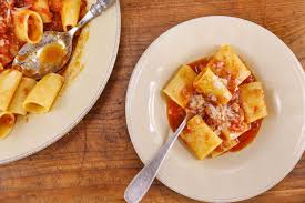 paccheri all amatriciana pasta with bacon and onion sauce