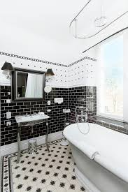 this bathroom proves that you can combine tiles in a lot of diffe patterns in one