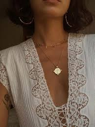 16 coin necklaces we re coveting who