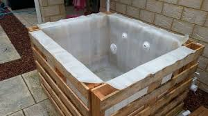 this is such a cool idea for a hot tub it requires mostly upcycled materials and i love it when someone looks at a bunch of old items and has a plan