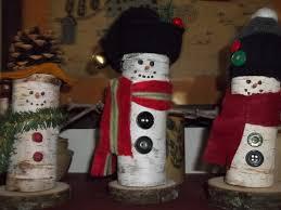 Little snowmen made from birch tree limbs.