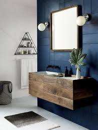 13 ideas for creating a more manly masculine bathroom a dark blue accent i like the blue wall coverings in combination with wooden stand for the basin