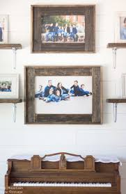 i made these farmhouse picture frames for my sister in law when we made over her formal living room more on that soon she had these beautiful family